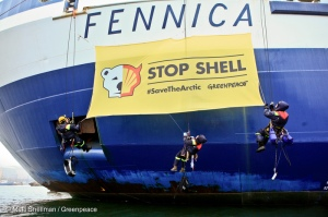 Greenpeace activists board the ice breakers Fennica and Nordica in Helsinki. The activists protest against Shell's Arctic oil drilling plans by dropping banners reading